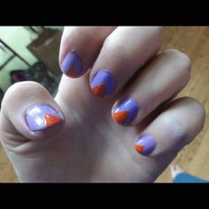 Triangle nail design. I did this to my nails. Just different colors. :)