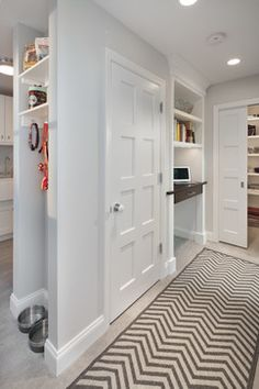 Nice little dog nook for feeding and accessories, great use of an end space. by Anthony Wilder Design/Build Inc.