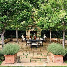 Step Into an Oasis | Sunken Terrace: Its centerpiece is a 20× 20 foot terrace that sits about 2 feet lower than the surrounding grade. Stepping down into it feels like entering a room.  A low stone wall around the terrace adds a sense of enclosure and offers extra seating.