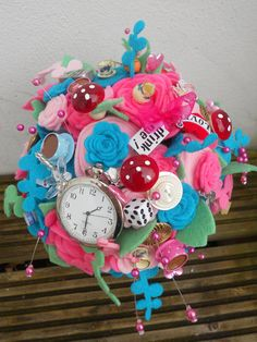 Another Alice in Wonderland themed bouquet, so much detail in this.  Is quite specific along the Alice theme so probably would not fit in unless you were fully theming your wedding but wow, what an addition if you are. And incredibly reasonably priced...  ---  £95.00, via Etsy.