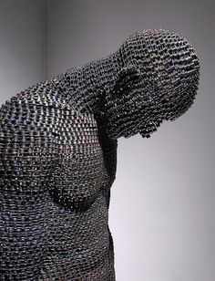 Made entirely of links of bicycle chain.