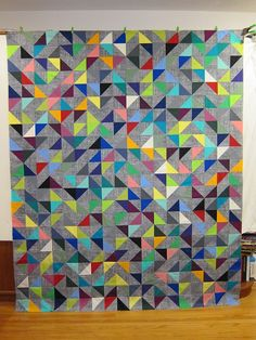 """Random Vector"" quilt by Susan of SKquiltlabs. This quilt is laid out according to a random number generator for pattern orientation, and the maker tried not to repeat a color in any row/column - such precision and planning for something so seemingly ""random."" Wow!"