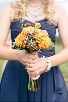 orange bridesmaid bouquet http://www.weddingchicks.com/2013/10/25/navy-and-orange-wedding/