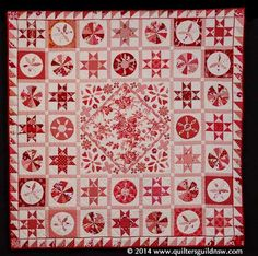 Mrs Williams in Red and White by Anne Andrews.  2014 Sydney Quilt Show. 4th place, predominantly hand quilted.  'A Tribute to Mrs Williams' quilt pattern from Threadbear Quilting