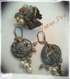 October Challenge piece using  luggage tag for the ring base and little green patina leaves from B'sue  Boutiques the earrings are polymer clay that I molded from the face on the side of the luggage tag.