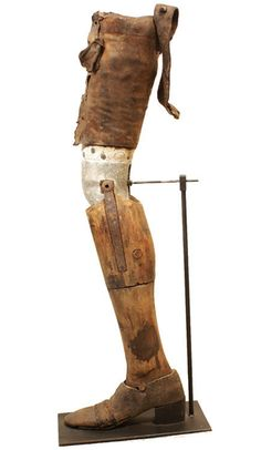 This prosthetic leg was found in Woodhull, Illinois. The sculptural leg is made of hand-carved wood, leather, and hand-forged iron and zinc.