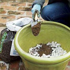 To boost planter drainage and make heavy pots easier to move, pour leftover foam packing peanuts into the bottom and add soil on top. | Photo: Wendell T. Webber | thisoldhouse.com