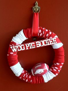 I would obviously NOT do Razorbacks....but it's a cute idea! LOL Razorback Sock wreath. These socks came from 2-3pks. from the Dollar Tree. Cut the toe off of each & carefully cut an opening in a foam wreath. Carefully slide each socks on, hiding the heels on the back of wreath & in the scruntches. Then decorate with whatever extras you desire! The football, ribbon, & painted wooden letters are just hot glued onto this wreath.