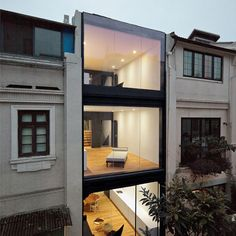 Chinese architecture studio Neri&Hu sliced away the rear wall and replaced it with glass for this renovation of a 1930s townhouse in Shanghai.