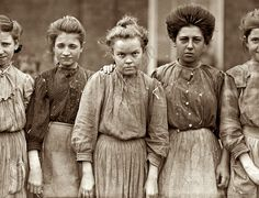 Hard working women from a cotton mill,1909.    Their faces tell such a story...