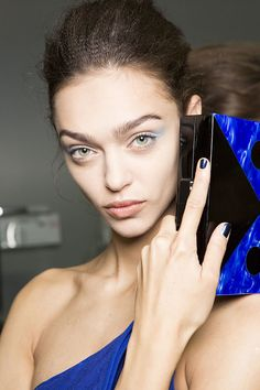 Blue was the primary color theme on the Emporio Armani runway, so of course the tips were painted a navy shade. #MFW