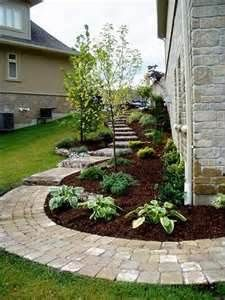 great path leading from the front of the house to the back, with beautiful design. ~It's beyond important to have as beautiful of an exterior as and interior~
