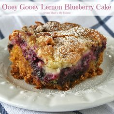 Ooey Gooey Lemon Blueberry Cake is full of blueberries with a zesty lemon cream cheese topping. #ooeygooeycake #lemonrecipes #blueberry recipes