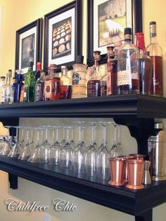 Create a makeshift bar by putting your liquor and cocktail supplies on shelves. diy liquor shelves, dining rooms, basement bars, organizing tips, decorative bottles, cocktail, bar carts, basements, home bars