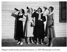 Flappers drink bootleg alcohol in unison, ca. 1925.
