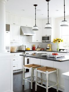 A Cottage Kitchen  Plenty of fresh white and attention to detail melds this new home's kitchen with its Colonial America surroundings. The U-shape kitchen in a Massachusetts home overlooks the ocean and combines modern kitchen functionality with an aesthetic rooted in history.