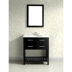 "Add classic style to your master bath or powder room with this vanity. Showcasing a lacquer-finished wood base, and white countertop, this eye-catching design adds timeless elegance to your decor.  Product: Bathroom vanityConstruction Material: HardwoodColor: Black and whiteFeatures:  Two functional drawersOne bottom shelfThree pre-drilled faucet holes for standard 4"" center faucet 105 Degree hidden hingesDimensions: 35"" H x 30"" W x 21"" DNote: Faucet and mirror not included"