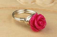 Create a resin or polymer clay rose using a mold, then add to wire wrapped ring base