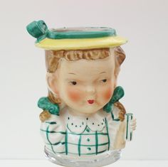 This vase is missing the umbrella that would have been in her left hand.  Porcelain Girl Head Vase Head Vases Vintage Vases  by WhimzyThyme, $30.00