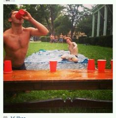 SLIP CUP...race opponent down slip and slide, flip cup, next person goes once their teammate flips cup correctly...SO DOING THIS