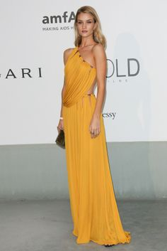 Rosie Huntington-Whiteley stunned in a mustard-hued goddess gown from Emilio Pucci's fall collection at amfAR's 21st Cinema Against AIDS Gala. [Photo by Tony Barson/FilmMagic]