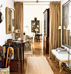 Floor to ceiling drapes in yep, burlap. Draws your eye to the tall ceilings.