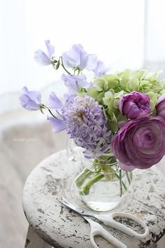 a lovely flower arrangements of green and purple