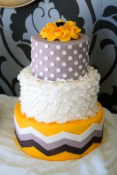 Love this yellow, gray and white wedding cake!