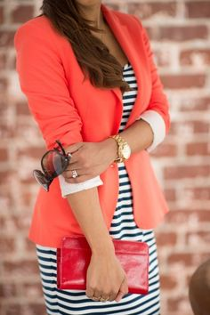 Coral blazer with navy and white striped dress.