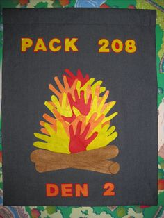 Our Wolf Den flag.  Created a stencil of the scouts handprints (elective 12e) and then cut out felt handprints.  Used tacky glue to glue handprints to the flag.