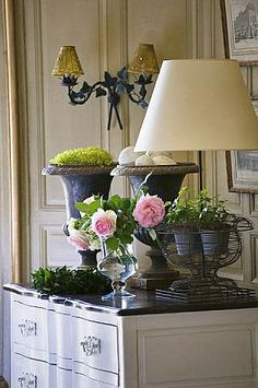 urns with moss or balls