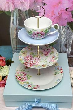 Create your own stand from tag sale teacups , saucers, and plates