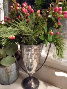 My kind of Christmas decorating.   Natural evergreens & berries in antique silver.