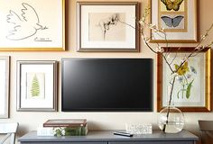 Tv and art can live on the same wall. wall art, tv walls, frame, gallery walls, galleri wall, art displays, tvs, wall galleries, art walls