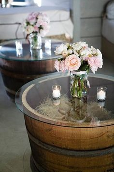 Barrel tables. Home Depot has whiskey barrels for $20. You can even change out the decor inside the barrell to fit the seasons! Cute for a porch or outdoor area!  I love this idea. pretty, rustic and simple