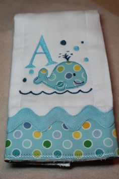 Personalized and appliqued burp cloth baby boys and girls with whale. $16.00, via Etsy.