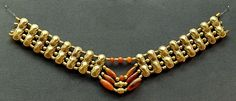Necklace with gold beads in the shape of double figure-of-eight shields, spiral gold beads and cornelian beads.  Cypriot artwork with Mycenaean inspiration, ca. 1400-1200 BC. From Enkomi  The British Museum