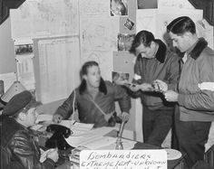US Eighth Air Force bombardiers study a target