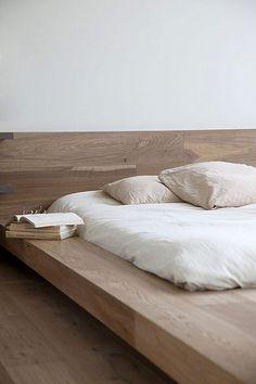 Bed, pillows, mattress, wood, books