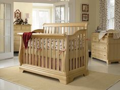 a Young America Built To Grow Sleigh Crib in a Natural wood stain finish is soft and soothing