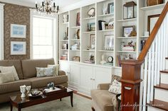 wall shelves living room, couch, bookcase styling