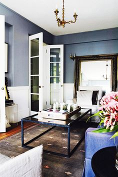 Tour a Euro Chic Apartment in Sydney // Deep Blue-Gray Living Room