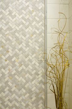 Wallcovering:  A tailored to Herrigbone blend with Smoke Limestone, Bianco Antico Marble, White Onyx and Spring White Marble.