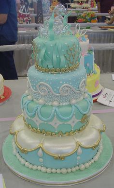 "Gorgeous under the sea cake. Could be a ""under the sea"" themed wedding cake as well."