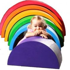 Extra Extra Large Wooden Rainbow Tunnel from Grimm's Spiel & Holz of Germany. It's furniture, art and a play set all in one