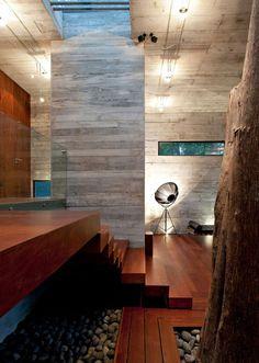 modern interior design: clean lines; concrete walls and hardwood floor