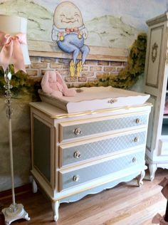 love the humpty over the changing table and the renovated dresser with stenciled drawers and gilt edges. So cute. Classic French Nursery