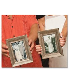 Plan with the photographer to take a picture of the bride and groom holding pictures of their parents' wedding days. This will become a treasured keepsake for the parents. You can print the photos at Kodak Picture Kiosk. #wedding #photography #ideas