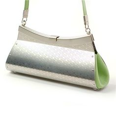 la-pochette handbag by wendy stevens.  pistachio colored leather mixed with a patterned, metallic shell.  in love.