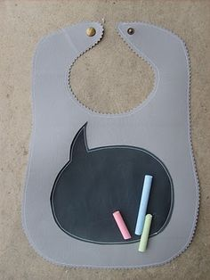 chalkboard fabric on a bib!  great idea for pictures!